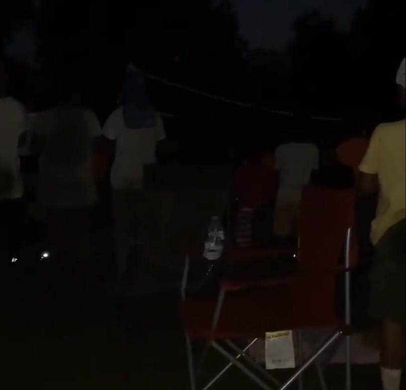 children-praying-at-camp-site